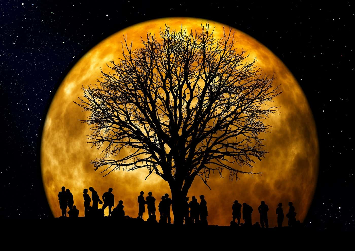 Silhouettes of people in front of large moon