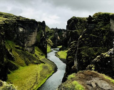 Cliffs with water running between them in Iceland - Poems by Alice Shi Kembel