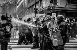 Police with water guns
