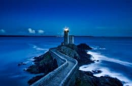 Path to lighthouse in ocean