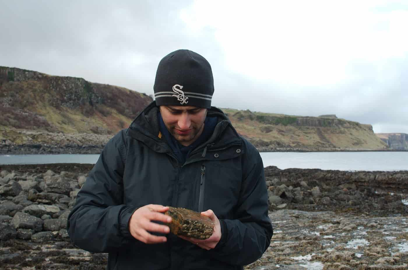 Paleontologist Steve Brusatte inspecting a fossil