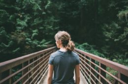 girl standing on a bridge