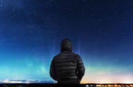 Man looking at stars at night