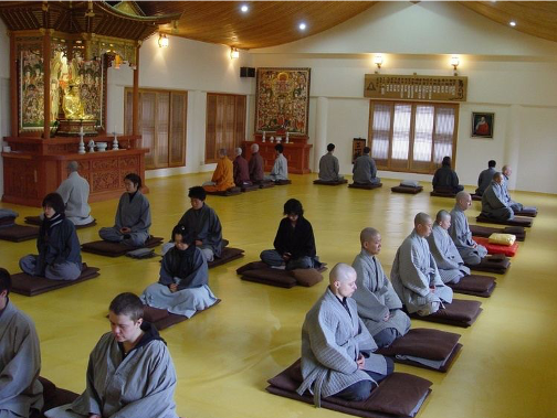 People meditating in a hall
