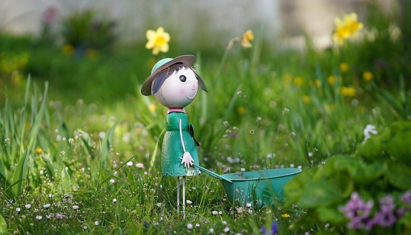 doll with wheelbarrow in garden