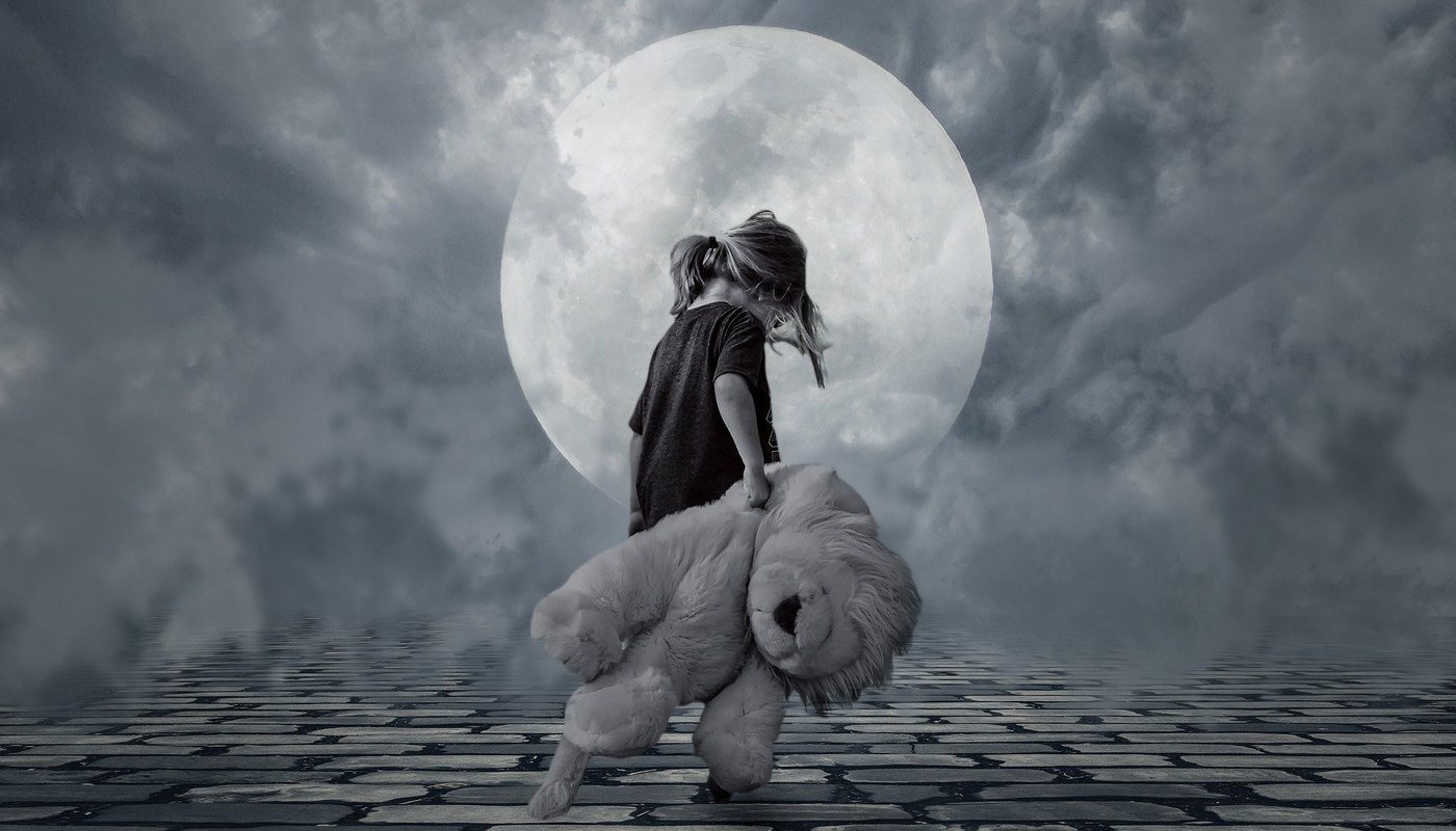 little girl dragging teddy bear