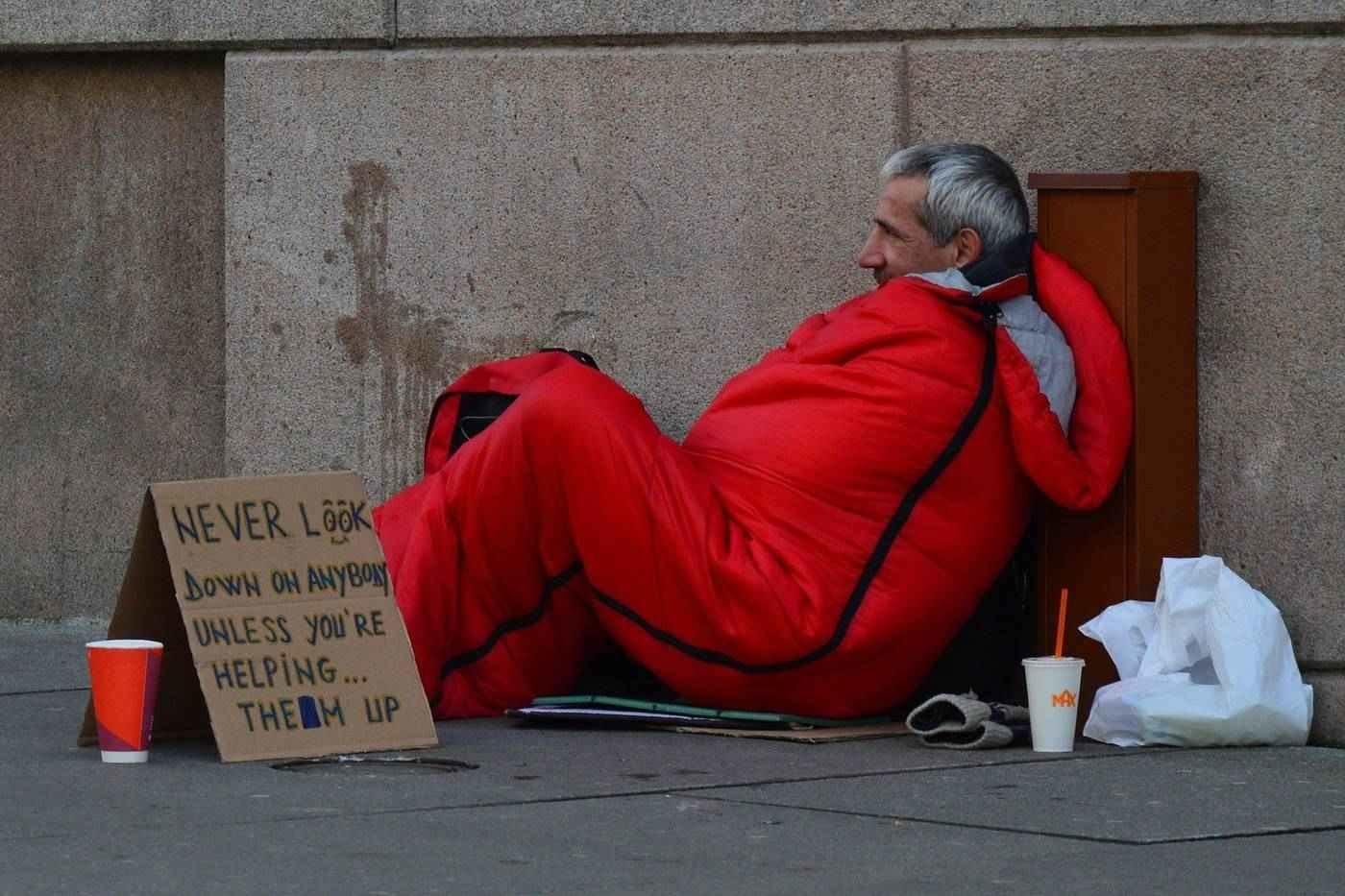 Homeless man in sleeping bag