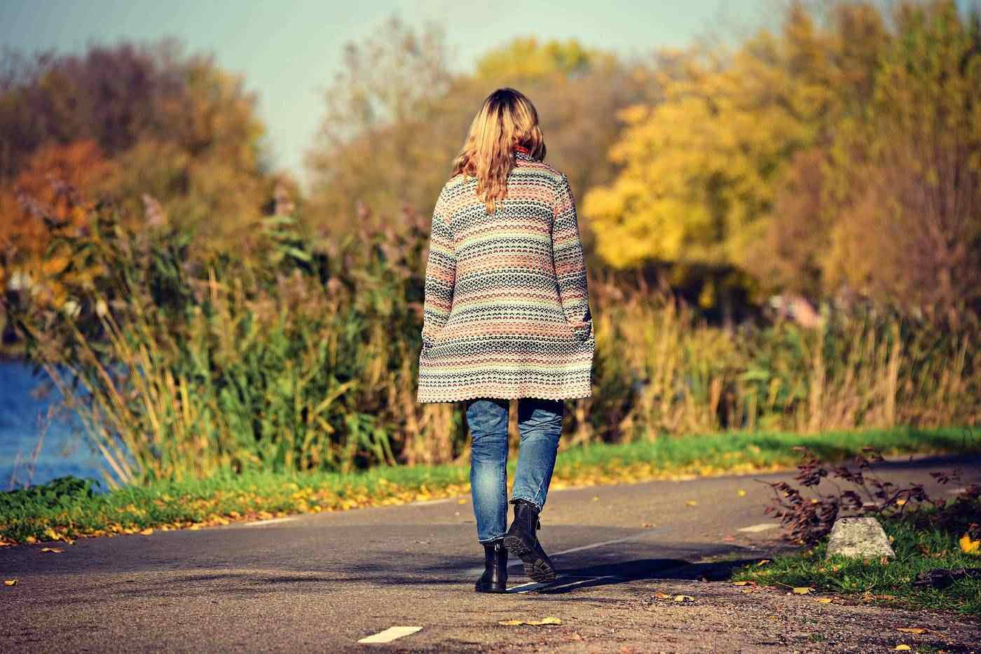Home.fit social-distancing-woman-walking 5 Questions to Ask Yourself Each Day