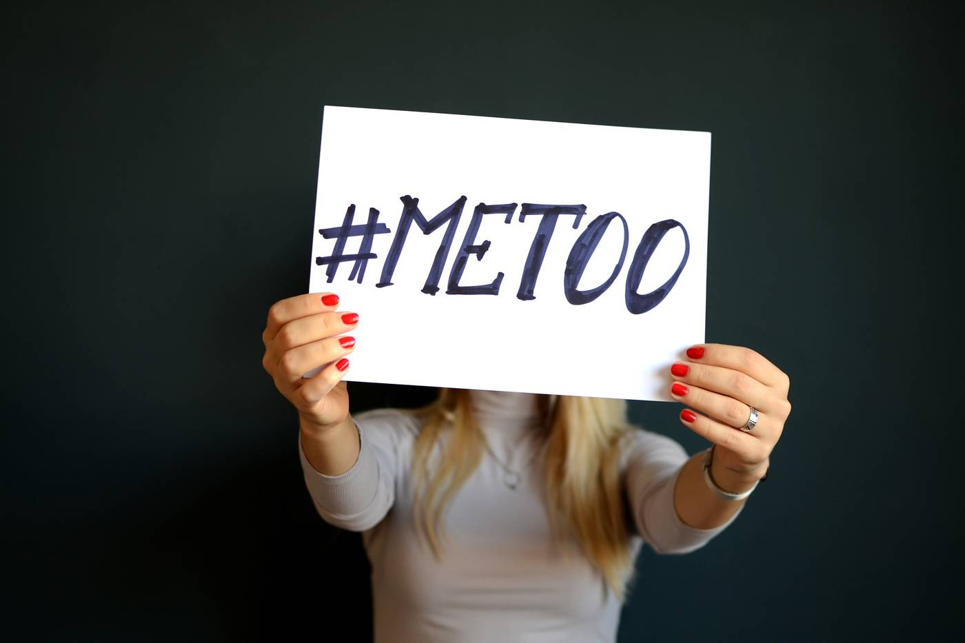"Woman with ""Me Too"" sign"