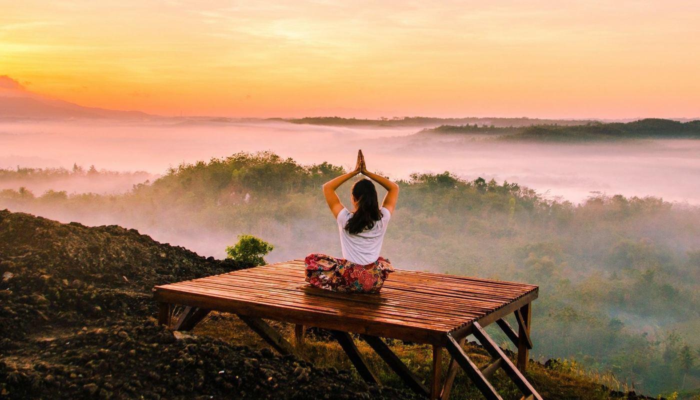 woman meditating on a platform