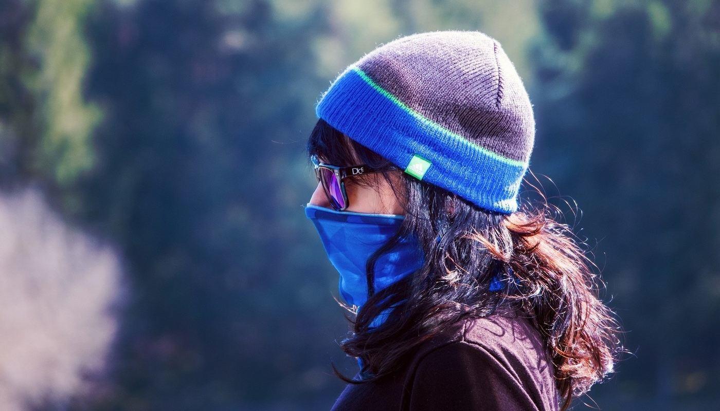 woman wearing a face mask walking