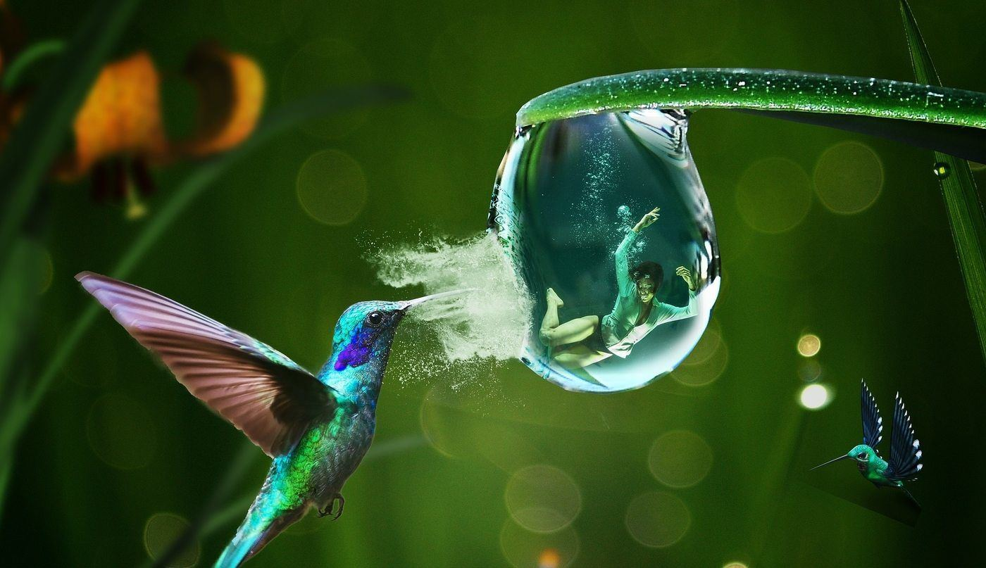 woman in water bubble with hummingbirds bursting it