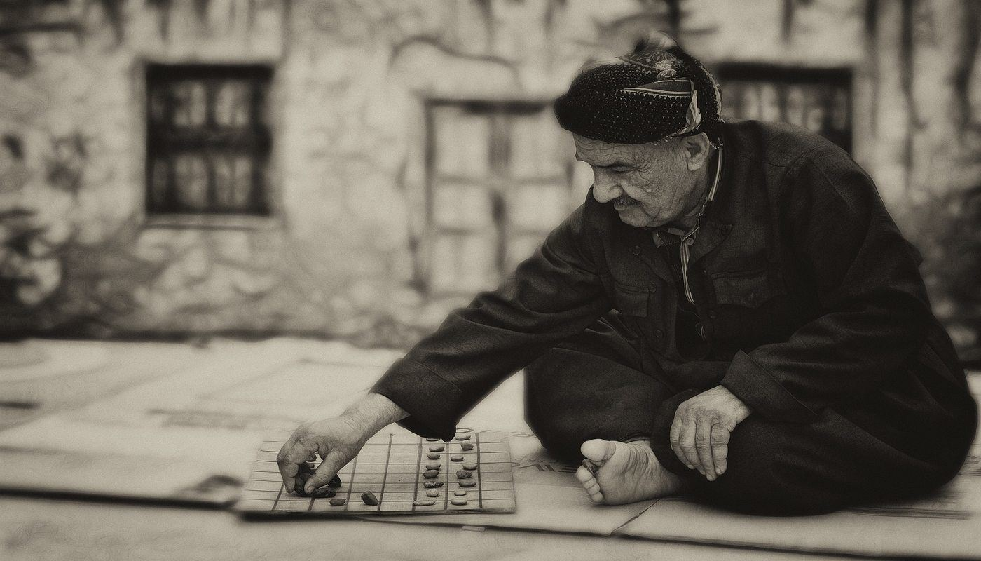Man playing a solo game on a sidewalk